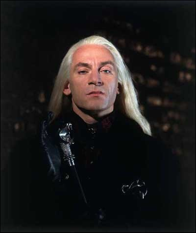 What creatures live in the front yard of Malfoy Mansion?