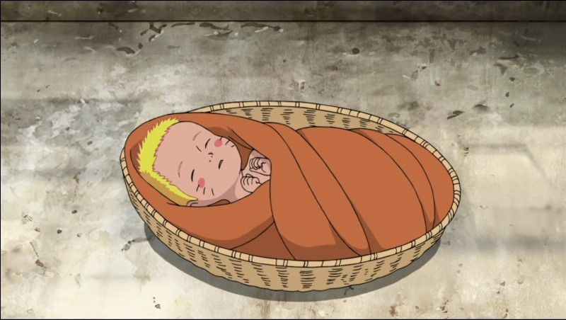 Who was the first person to hold Naruto when he was born?