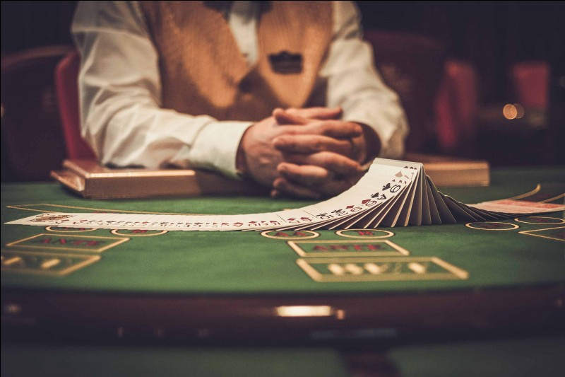 Who gives out winnings to participants and takes the lost stakes?