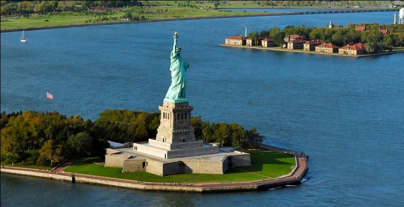 What is the name of the island that houses the statue?