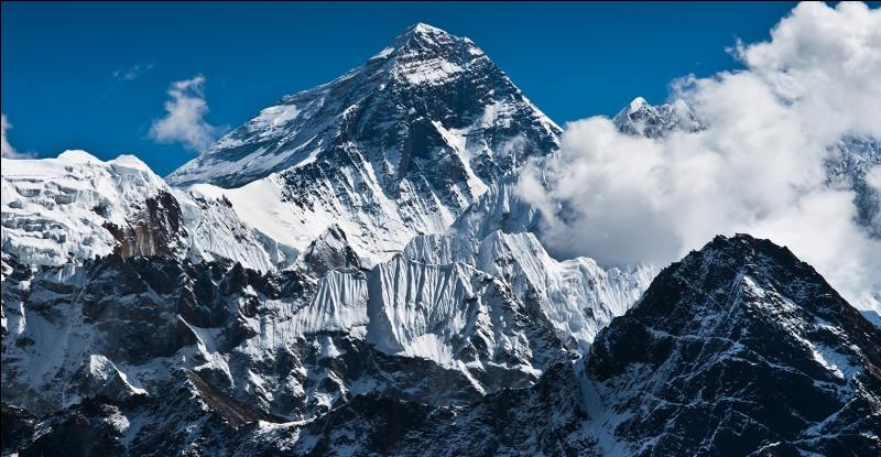 What are the names of the first climbers who reached the summit of Mount Everest?