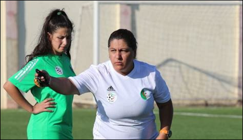 What country is the coach (Soccer) Naima Laouadi from ?