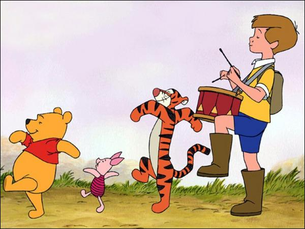 What is the first name of the little boy who is having crazy fun with Winnie the Pooh and his friends ?