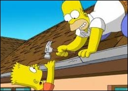What part of the body does Homer injure himself with a hammer while trying to repair the roof of his house ?