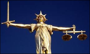 What does this London statue situated on the rooftop of the Old Bailey represent ?