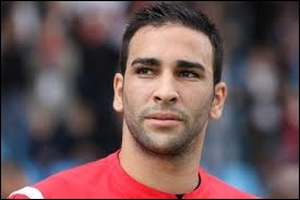 Was Adil Rami part of Domenech's France team during the 2010 World Cup fiasco in South Africa ?