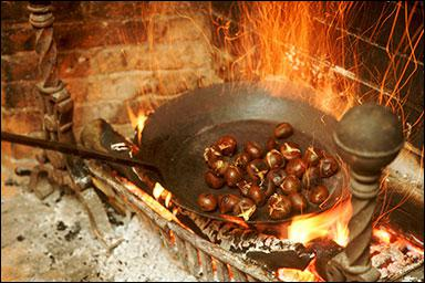What is the main hazard of roasting chestnuts on an open fire?