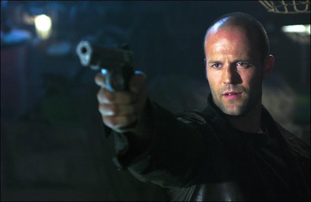 Jason Statham Holding a Gun in...
