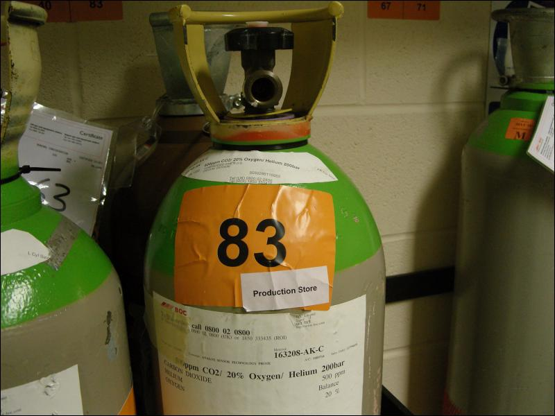 Why is it important to eliminate, where practicable, the number of gas bottles stored in the Hot room overnight?