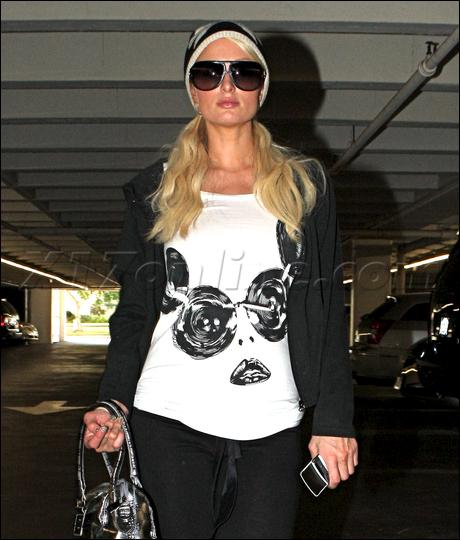 Paris Hilton is wearing... .
