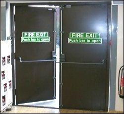 What is the required position of the Fire exit doors at Analox?