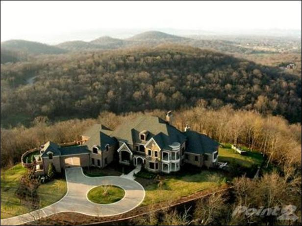 Whose home is located in Franklin Tenn? This home features a theater a wine cellar and a bar. This expansive property also includes a pool, hot tub and a guesthouse. This home is 13, 380 square feet.