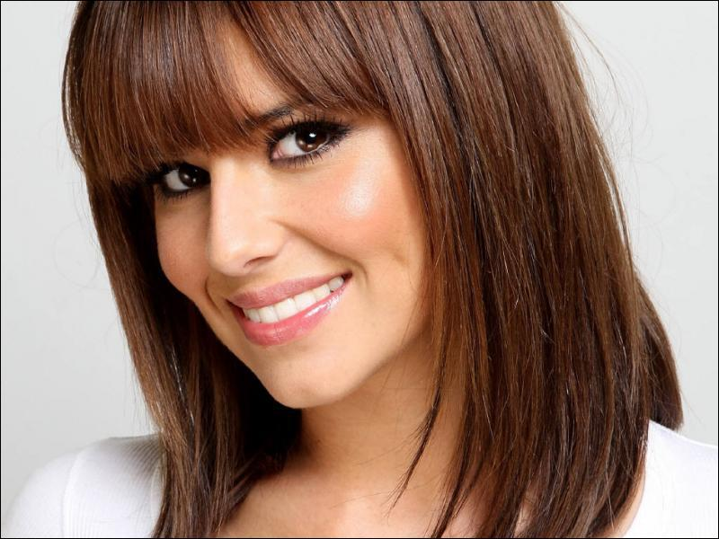 What was Cheryl Cole's first song as a soloist?