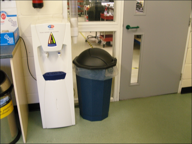 In the canteen there are 2 general waste bins and one other bin located to the right of the water cooler. What is this bin specifically for?