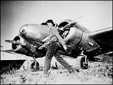 Was Amelia Earhart flying solo on her trip around the world?