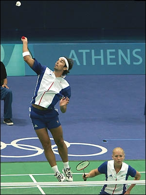 A badminton player practicing the overhead clear and moving a step back each time he hits 5 successfully to the back of the court would be showing signs of what in his training?