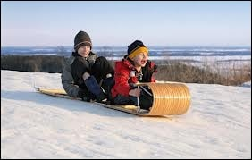 What do Canadians call a wooden sled that curves up at one end?
