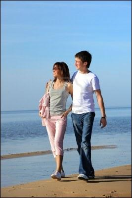 This is a photograph of my girl friend and ... walking along the shore.