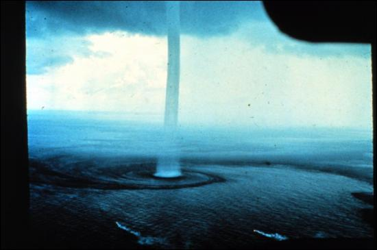 A... is a tall column of water pulled up from the sea during a violent storm.