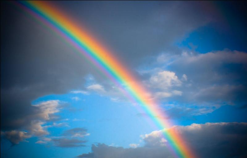 A ... is a spectrum of light that appears when the sun shines through the rain.