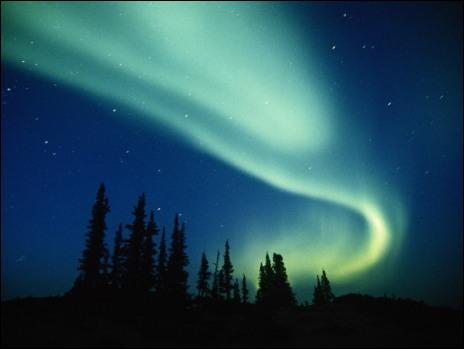 ... are curtains of colored light visible during the night near the North Magnetic Pole.