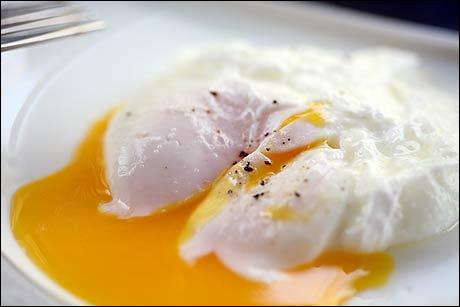 Break an egg into simmering water. Cook for 3-5 minutes. Remove with a slotted spoon. This ... egg is healthy since you don't need butter or oil to cook with.