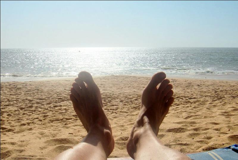 Yesterday, my friend and I ... on the beach the whole afternoon.