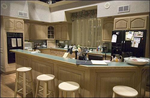 Which family gathers in this kitchen?