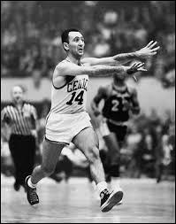 How many assists per game did Bob Cousy average during his career?