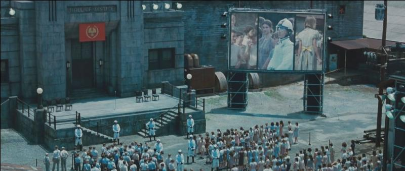 At what age do they participate in the Reaping day? And which district does Katniss live in?