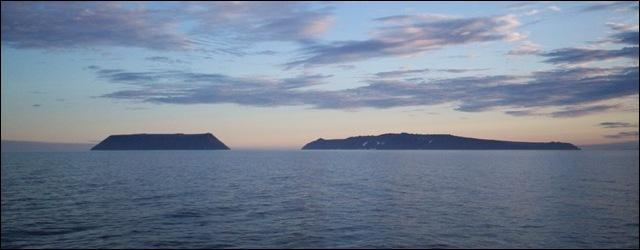 In the middle of the strait you can see two islands : ... Big Diomede and ... Little Diomede. They are separated by the International Date Line.