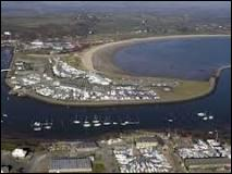 On which part of the coast can Pwllheli be found?