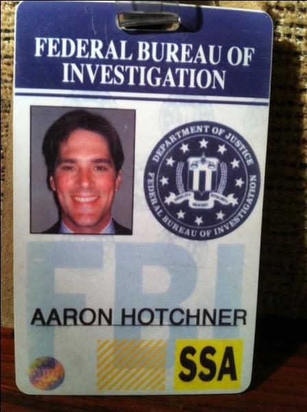 In season 2, who is hired by Strauss to help her to transfer Hotch?